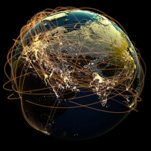 Global communications, rendered as many glowing lines encircling the planet